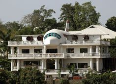 "This home in Nigeria was partially designed in the shape of an airplane. It's in the city of Abuja, and was created by a couple to display their love for traveling. There's a kitchen and computer room in the ""plane"" part of the house."
