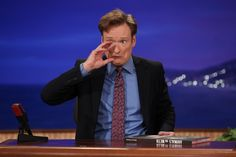 Conan Is Mock-Drunk While Introducing New Coffee Table Books