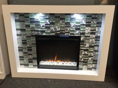 Retails for $1,596. Our price $798 Dimplex, World Market Furniture, Fireplace Heater, Mosaic Glass, Mosaic Tiles, Dimplex Fireplace, Glass, Mosaic Tile Fireplace, Fireplace Tile