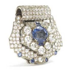 Cartier,  Paris, c. 1925 -  Sapphire and Diamond Clip/Brooch.  Length: 1-1/2 inches Sapphires approximately 6 carats  Diamonds approximately 11.5 carats.