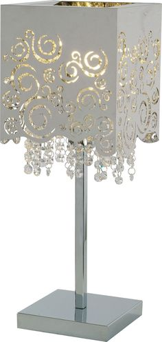 Intricate laser-cuts transform thin sheets of chrome into artistic works of lace and lattice on this accent lamp