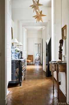 Paris Apartment... Love the mix of African and Chinoiserie
