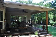 Covered patio and sunroom addition in Denton, Texas. This project included adding a covered patio to the back of the home and a sunroom addition. Deck With Pergola, Patio Roof, Backyard Patio, Pergola Ideas, Patio Ideas, Porch Ideas, Pergola Plans, Outdoor Ideas, Backyard Ideas