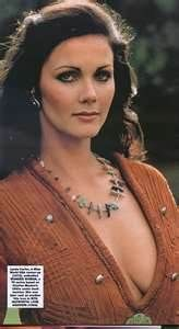 Lynda Carter 1970s hair in combs or barrettes. Pulling the hair back with combs orbarrettes was popular in the 70s