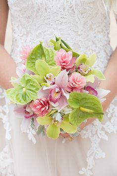 Tropical pink and green bridal bouquet at Aulani, A Disney Resort & Spa