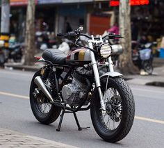 "dropmoto: ""The perfect little city slicker. Suzuki GN250 street tracker from the cats over at Shanghai Customs. Loving that front-end! Check out the whole story over on @bikeshedmc. #dropmoto #suzuki #gn250 #streettracker """