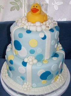 Two tier pokadots cake with rubber ducky topper