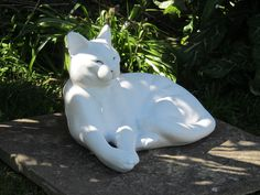 A Lounging Cat statue that has been painted, all of our statues can be painted.