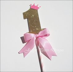 Our handmade baby girl's first birthday princess keepsake cake topper features a gold glitter number one with a pink glitter tiara, perfectly accented with a hand tied luxury pink satin ribbon bow. First Birthday Cake Topper, Baby Girl First Birthday, First Birthday Parties, Birthday Party Themes, First Birthdays, Birthday Ideas, Glitter Birthday, Gold Birthday, Princess Theme