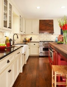 Loving the white cabinets with the dark wood floors and pop of color on the island