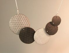 learn to make a polymer disc necklace
