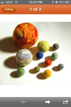 Needle felted solar system.   I can't recall where I found this on Etsy, I am so sorry for not giving proper credit - I captured on my phone. Must make for Henry!