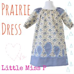Beautifully detailed handmade little girls prairie dress available in a selection of fabrics, this two fabric dress with coordinating Ric Rac trim will really stand out from the crowd at any occasion.  Fabric composition: 100% Cotton  Delivery time: 7-10 Working days from order (please enquire before ordering if needed urgently)