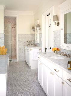 This is the opposite pic of the bathroom I have pinned. High tile wainscoting. Trim feeds into shower.