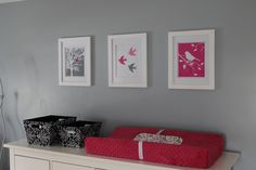 Closeup of changing area and wall prints