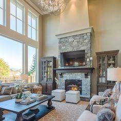 Large Living Room With Two Story Windows, Gorgeous Lighting, Large Area  Rug, Stone Fireplace Clay Construction Inc.