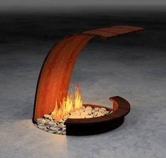 Sculptor and architectural designer Elena Colombo builds gorgeous, creative, unusual fireplaces and firepits. Click on the image to go to her website!