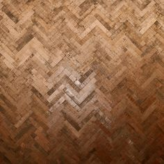 Copper Herringbone parquet flooring by Ted Todd, as seen as Decorex 2016