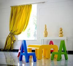 Alessandro Di Prisco has created a set of letter furniture for the little ones. Great colors.