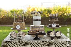 I like this safari explorer dessert table for Tyler's next party.  :)