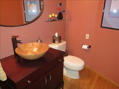 This half bath off the entrance is bright and attractive. Large Homes, Washer And Dryer, Swimming Pools, Ranch, Entrance, Sink, Bright, Bathroom, Black