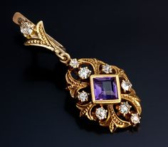 Vintage Amethyst and Diamond Gold Pendant Earrings.  These gold openwork pendant earrings with lily motif are handcrafted in 18K (750) gold, set with two step cut amethysts and eighteen old cut diamonds (over 1 ct tw).