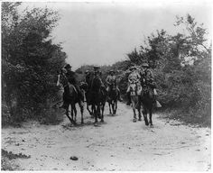 Genral Miles, Shafter, Wheeler [and 3 other soldiers on horeback] returning from the conference with Genral H. Toral which resulted in the s...