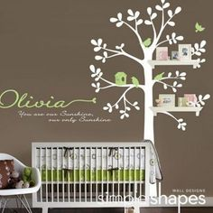 Tree painted to incorporate shelving with frames