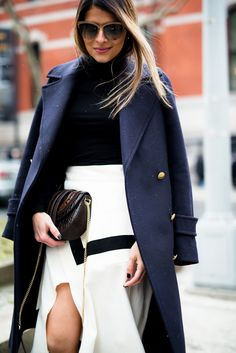 Pam Hetlinger, The Girl From Panama wearing a H&M navy coat, black turtleneck, finders keepers label lay it down skirt, barbara bui brown knee high boots, and salvatore ferragamo bag during New York Fashion Week.