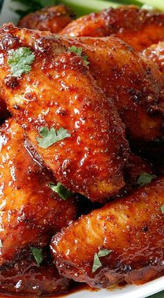 Sticky Buffalo Honey Hot Wings - the BEST buffalo wings you will ever devour and as easy as tossing in a rub, baking and coating in an easy, tantalizing sauce. #appetizer #wings #buffalowings