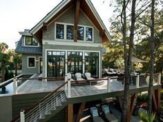 Two sets of French doors connect the great room to the back deck, which is elevated 10 feet above ground level and boasts stellar views of the marshland.