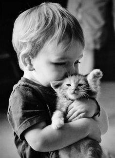 Little children and cats are a perfect mixture.... Unless the cat is angry!