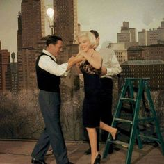 Marilyn Monroe, Yves Montand, and Gene on the set of Let's Make Love (1960).