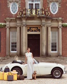 I love this car... and that luggage... and that dress... and that dog... the house isn't bad either...