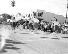Florida Memory - Majorettes and a marching band in a parade - New Smyrna Beach, Florida