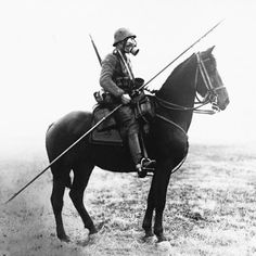"""How's this for a of a clash of eras? German cavalry lancer from WWI. Steel helmet like in WWII (for the first year of WWI soldiers wore cloth caps, can you believe it) gas mask, steel lance (with little eyelets for attaching a pennant!) and of course, the horse.   Listening to Dan Carlin's Hardcore History """"Blueprint for Armageddon"""" about WWI led me to this image."""
