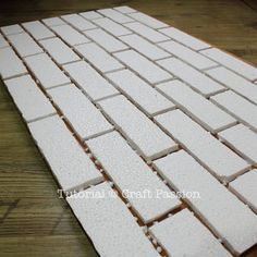 the coolest project I have seen in a while--a faux-brick wall made from foam and finished with spray paint |craft passion