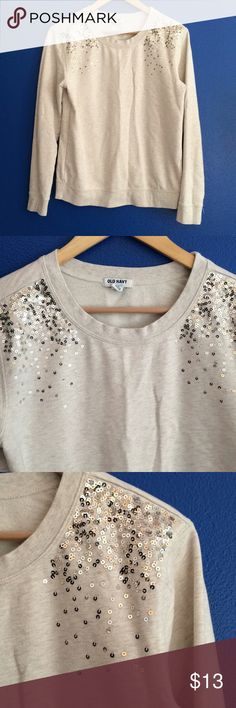 Old Navy tan and gold sequins embellished sweater Old Navy brand. Long sleeve sweatshirt. Embellished with subtle sparkle with golden tan copper color sequins bling at shoulders. Crewneck fit. Long sleeve soft comfortable material that hoodies are made of. Loose fit. Dresses up a casual look. Great for the office or date night. Cute with jeans and boots. Bundle with other items in my closet and save 20%. Old Navy Sweaters Crew & Scoop Necks