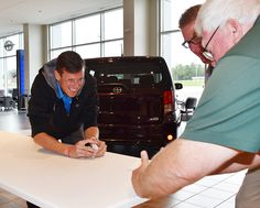 If you're in the Milton Ruben Toyota show room on Mondays in October, you'll see the sales people competing in the paper football tournament.