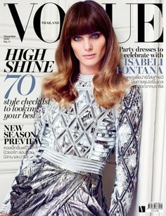 Landing on the December cover of Vogue Thailand, Brazilian top model Isabeli Fontana shines in a look from Balmain's fall 2013 collection.