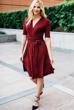 A figure-flattering Lucky Duck wrap dress in a beautiful burgundy for the fall season. It features acrossover V neckline, and a self-tie belt secures the wais