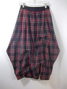 Lagenlook, fashion skirt. Wool blend, plaid, balloon, long skirt. This listing is for skirt only. An asymmetric, maxi/low calf, pull-on skirt in tartan plaid wool blend fabric. Black, red, green, and yellow tartan plaid Side pockets in seams. 2 inch wide black elastic waistband.   Hand wash cold or dry clean.   SIZES: waist - 22-23/hips - 31- 33 waist - 24-25/hips - 33- 35 waist - 26-28/hips - 36 -39 waist - 30 -32/hips - 40- 43 waist - 34-37 /hips - 44- 47 waist - 39-42/ hips - 48-50   The…
