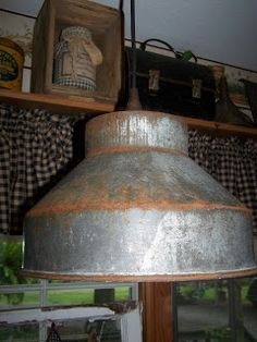 Old Milk Strainer~repurposed as a Primitive Light Fixture.Backdoor Primitives (this will be a fun project to add authentic appeal to the Dairy Museum. Primitive Lighting, Farmhouse Lighting, Rustic Lighting, Vintage Lighting, Cool Lighting, Primitive Bathrooms, Primitive Kitchen, Farmhouse Style Kitchen, Farmhouse Decor