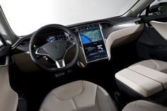 2013 Tesla Model S:  Wood, leather and a bigger TV than we had growing up.