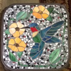 Stained glass mosaic table. May have to make some stepping stones!