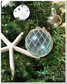 Faux Asian glass fishing floats DIY.  This is pictured on a Christmas tree but you could also make them to be used as summer-time beach-y decorations