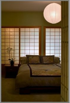 The wall of shoji screen was lit from behind to creat drama in this tranquil Chinese inspired bedroom