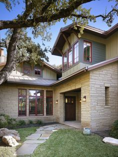 craftsman style. like the dormer windows wrapped around the sides.