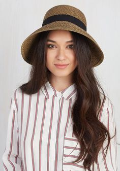 Situated beneath this tan sun hat, you approach the outdoor concert with the hope of finding a great view. A perfect spot appears deep in the crowd, but it's no problem - the grosgrain ribbon and petal-shaped brim of this black-flecked chapeau open a path of people adoring your classic style!