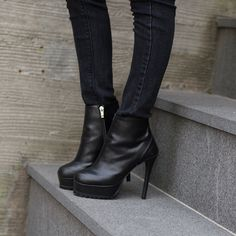 Today's Hot Pick :Stiletto Heel Ankle Boots http://fashionstylep.com/P0000CGK/pushpush7023/out Complete a sexy edgy look with these boots. These shoes have a side zip closure, round toes, front platforms, track soles, and high narrow heels. Match these boots with a black ripped skinny jeans and leather jacket over a sheer blouse.